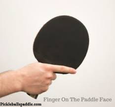 Putting fingers on the surface of the paddle